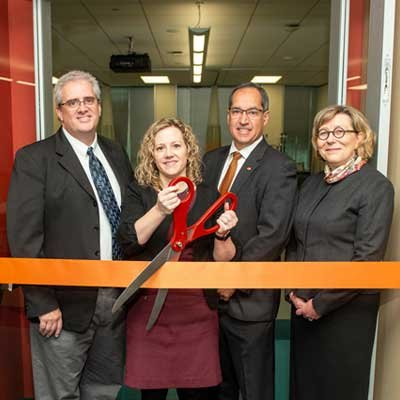 Photo of Diane Santa Maria, dean ad interim, and there other UTHealth leaders cutting the ribbon on the new simulation center at Cizik School of Nursing at UTHealth