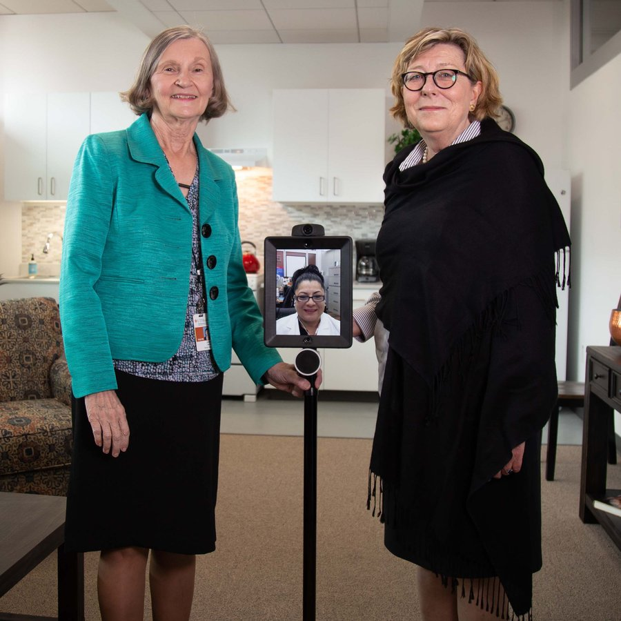 Cizik School of Nursing at UTHealth professors Joanne Hickey, PhD, RN, and Constance Johnson, PhD, RN, demonstrate robotic monitoring technology in the Smart Apartment.