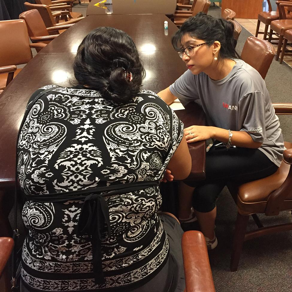BSN student Jocelyn Yanez, who served as a research assistant to Dr. Daphne Hernandez, interviews an immigrant parent. (Photo courtesy Hernandez.)