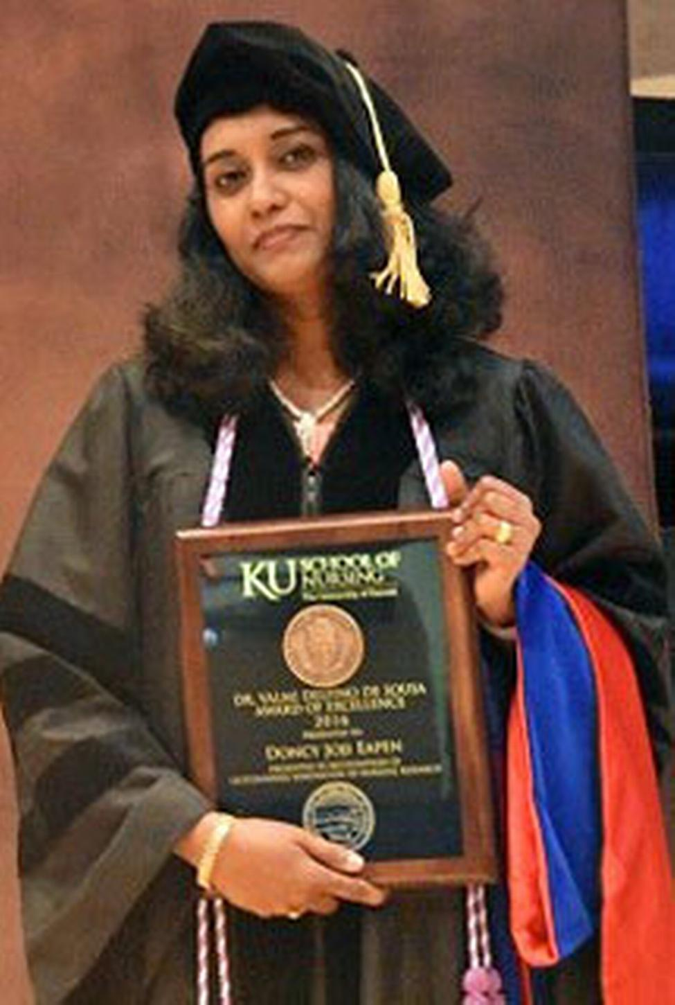 Dr. Eapen presented with the Dr. Valmi Delfino De Sousa Award of Excellence at KU School of Nursing's commencement in May 2016.